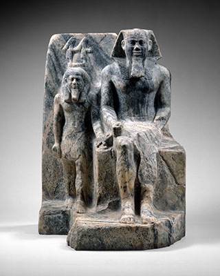 King Sahure and a nome god