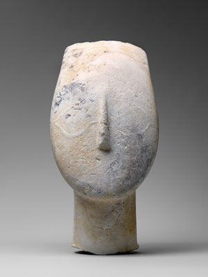 Marble head from the figure of a woman