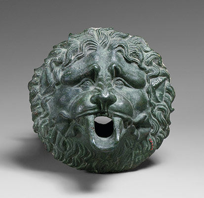 Bronze water spouts in the form of lion masks