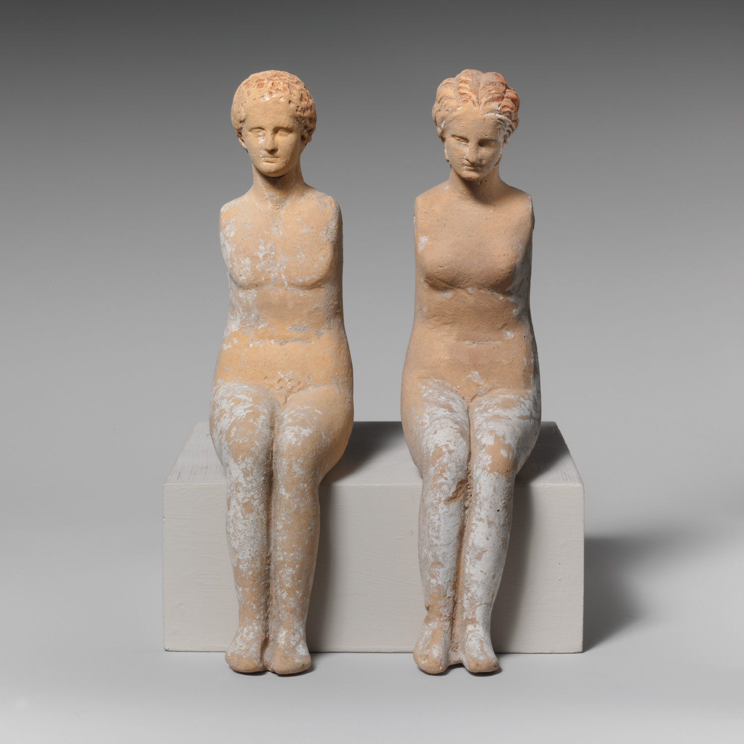 Two statuettes of youths, armless