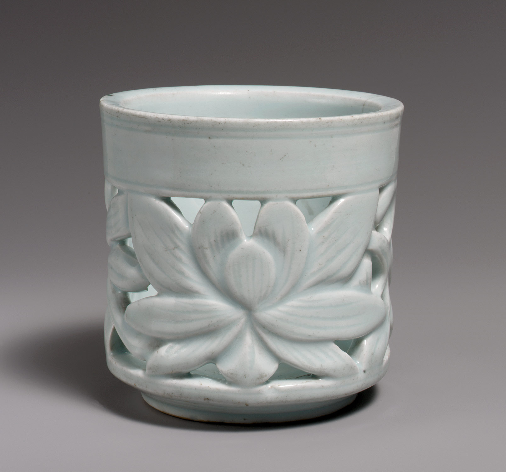 Brush holder with lotus decoration