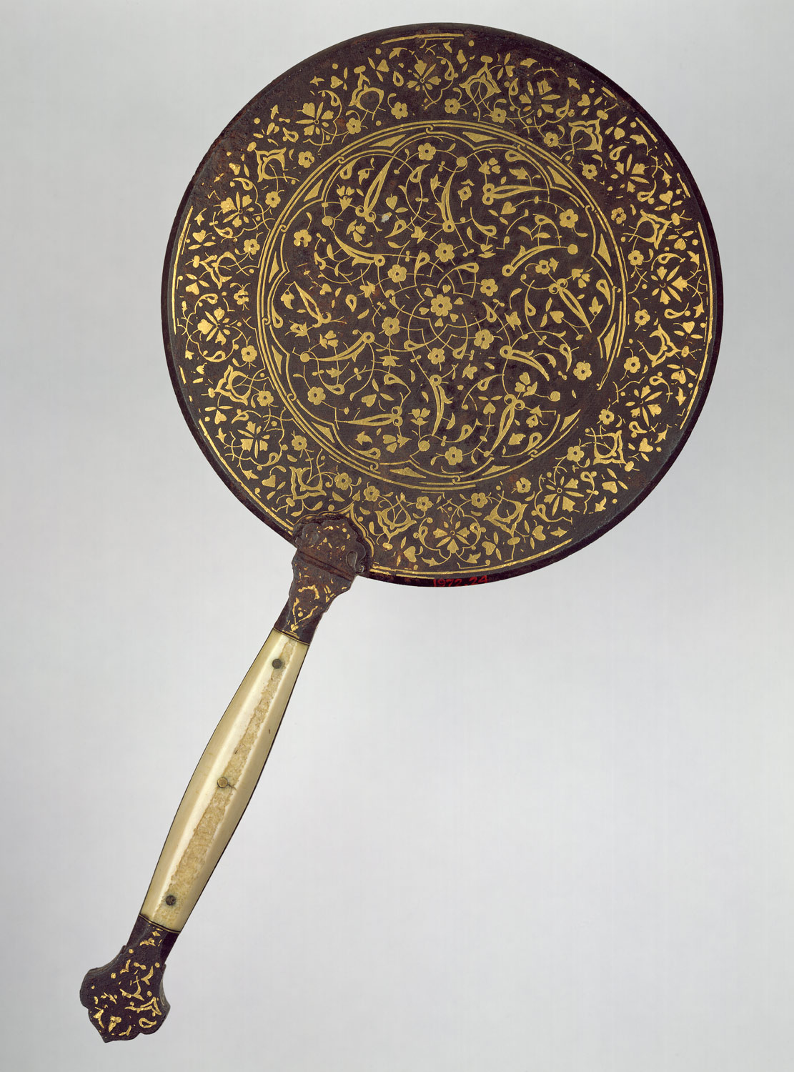Mirror with split-leaf palmette design inlaid with gold