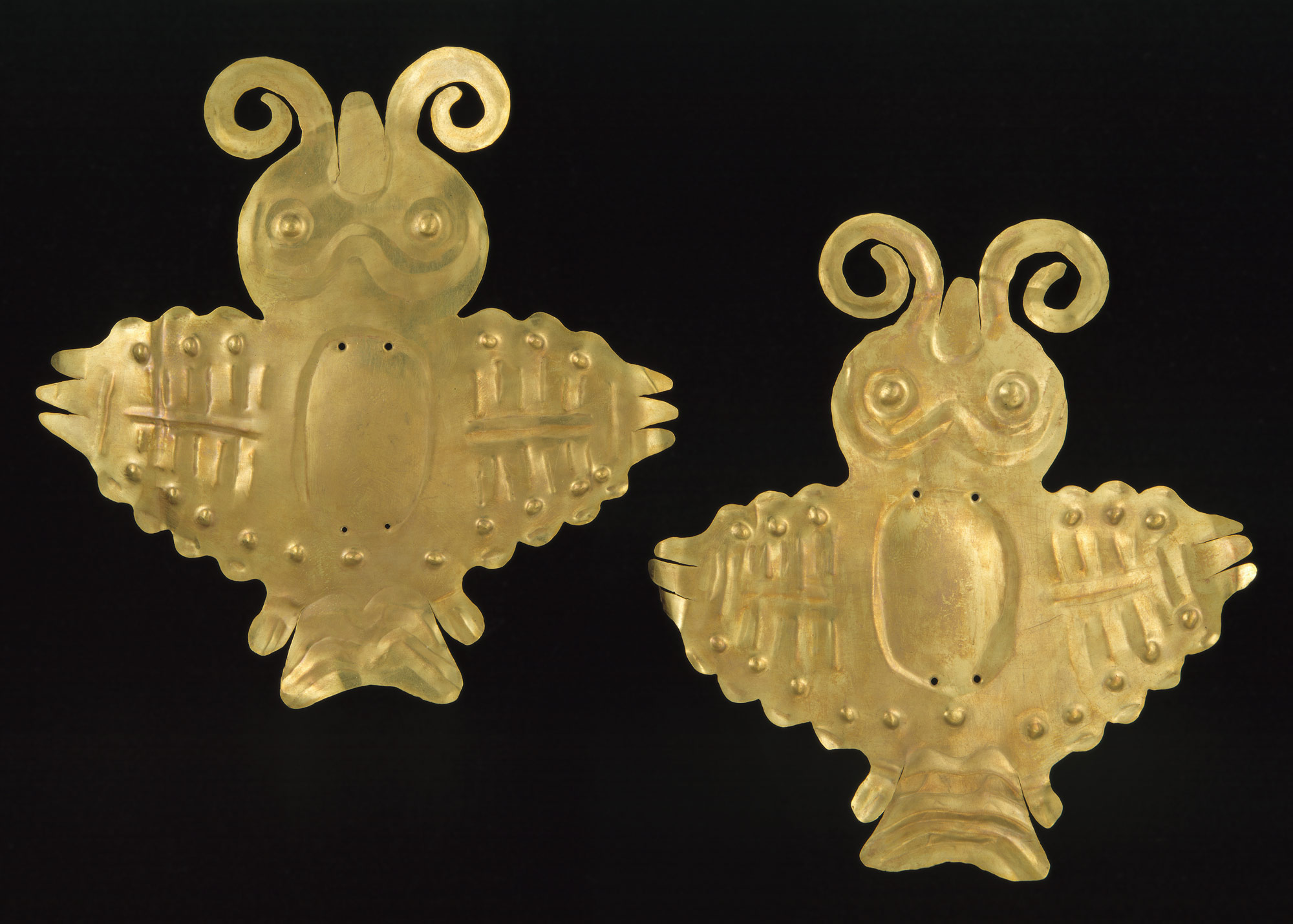 Two bird ornaments