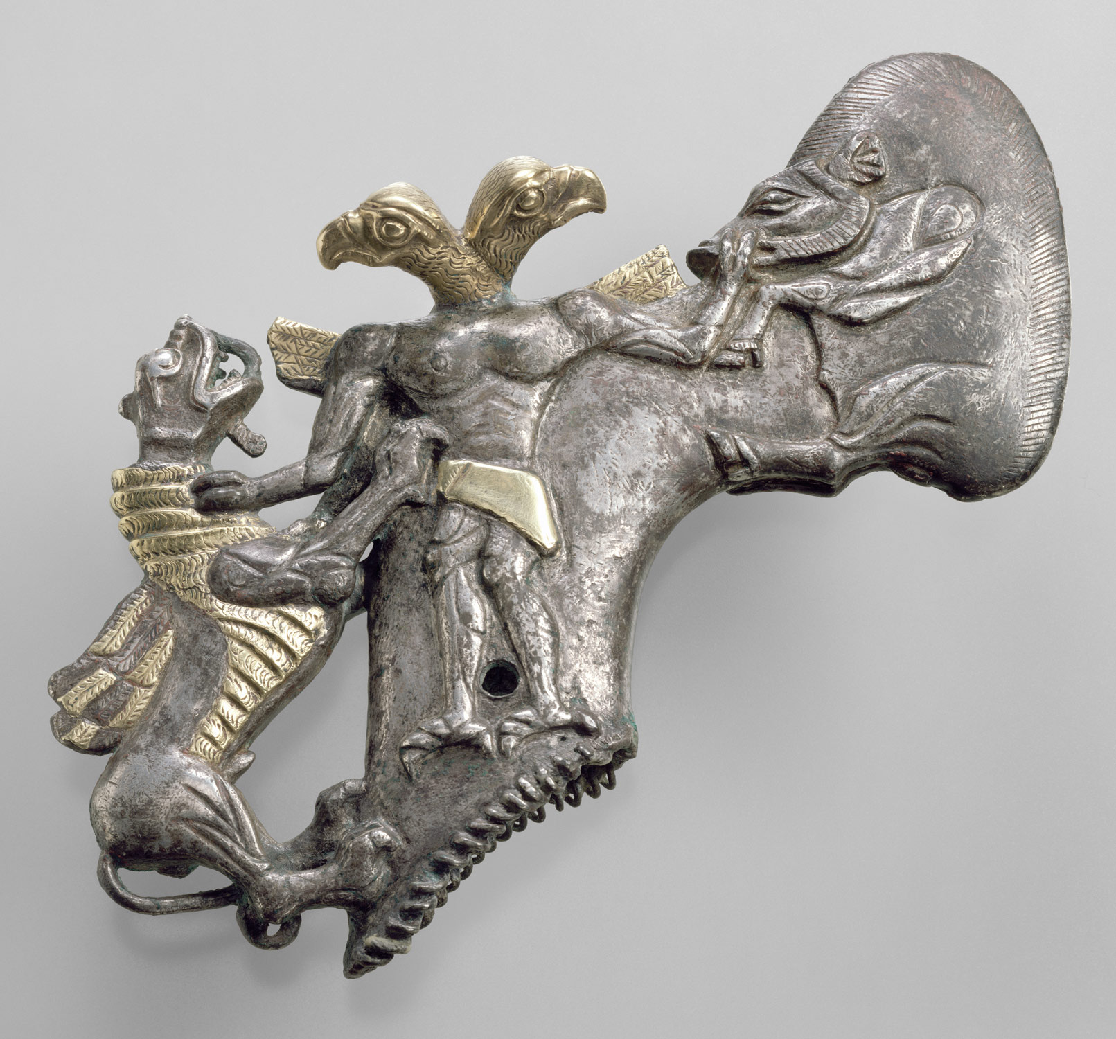Shaft-hole axhead with a bird-headed demon, boar, and dragon