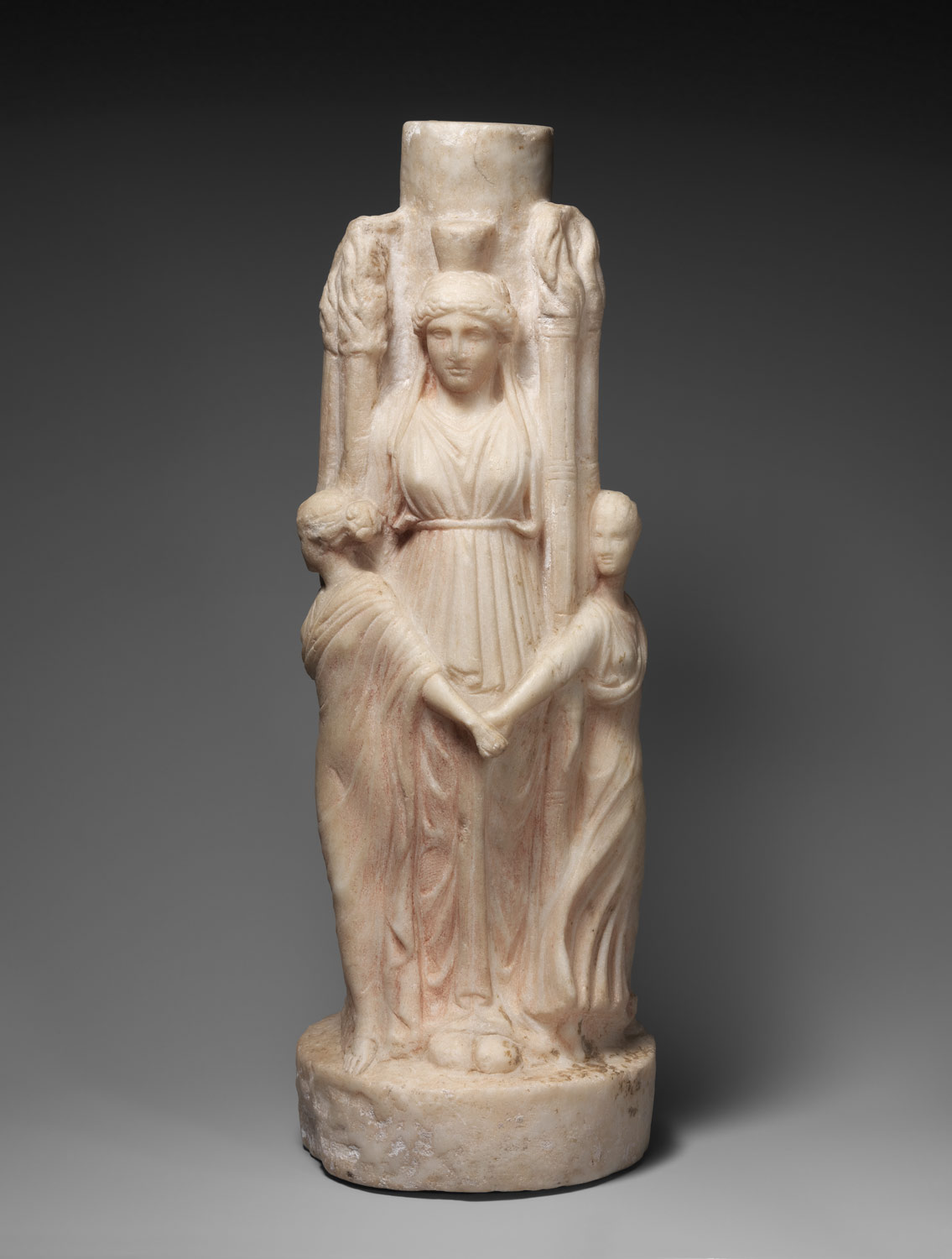 Marble statuette of triple-bodied Hekate and the three Graces