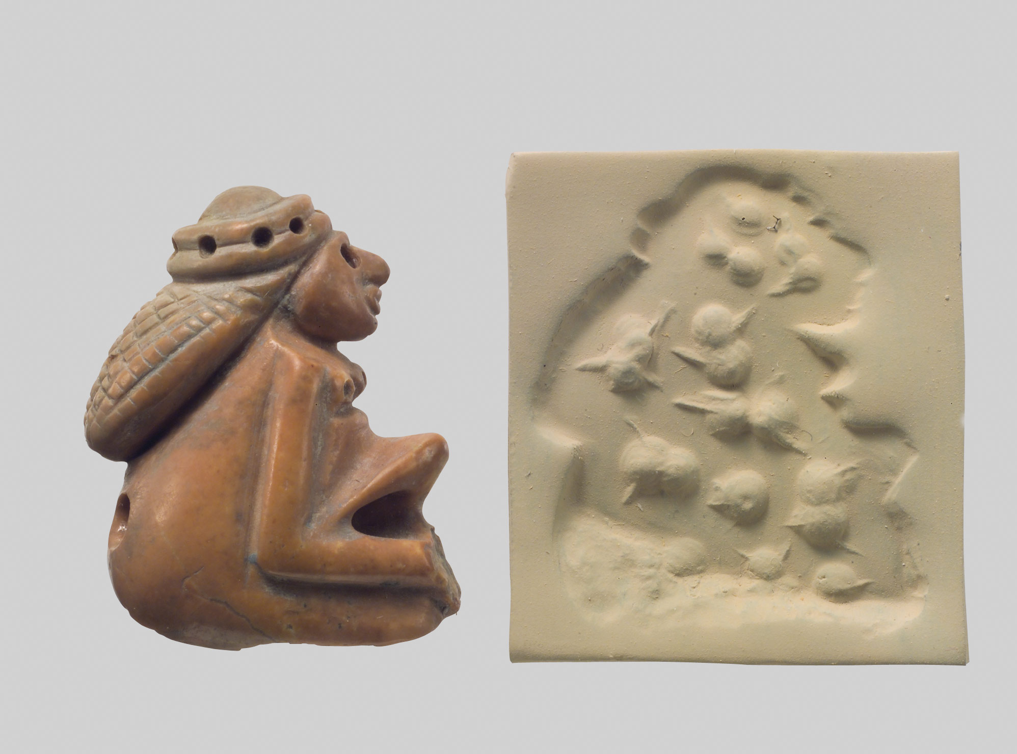 Seal amulet in the form of a seated female and modern impression