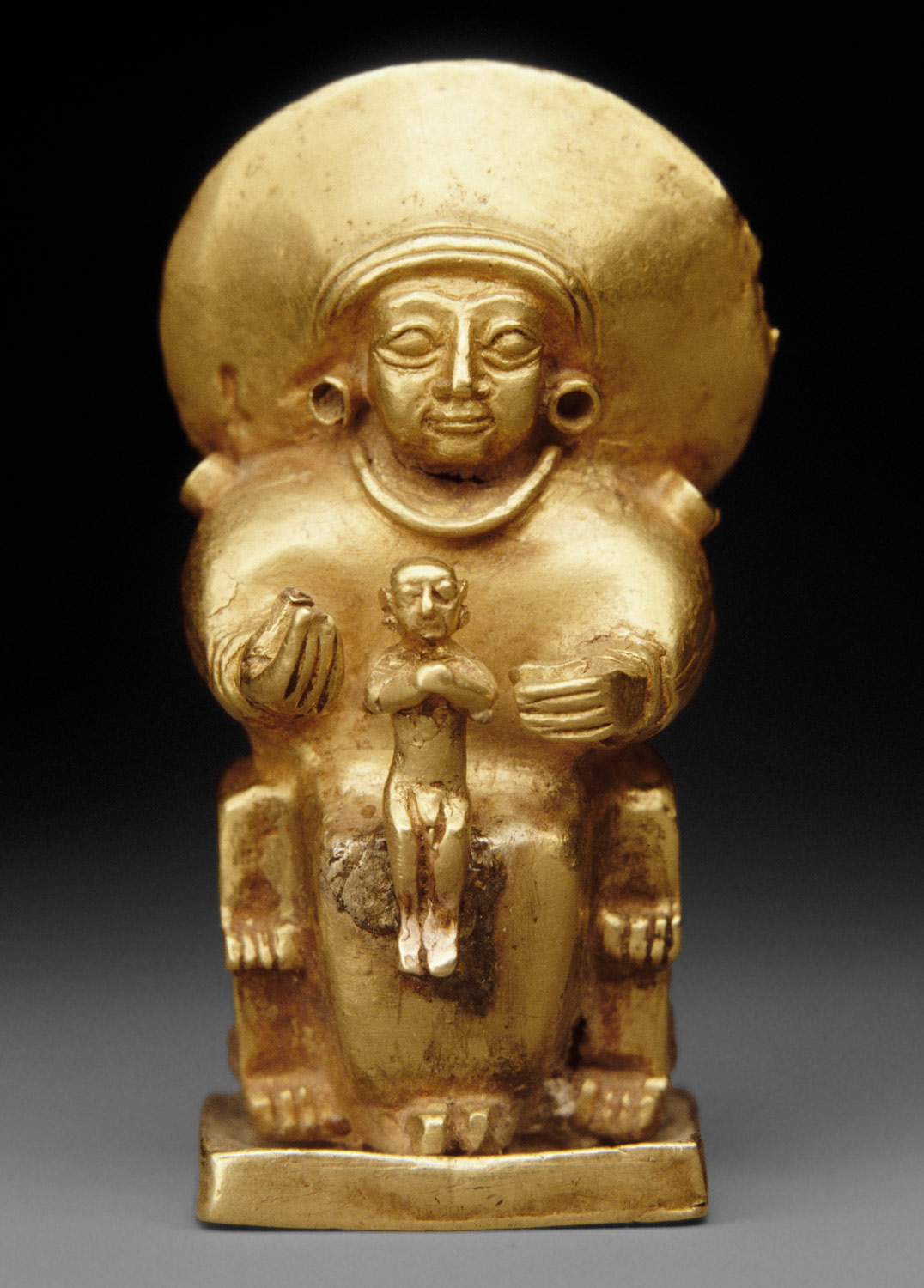 Seated goddess with a child