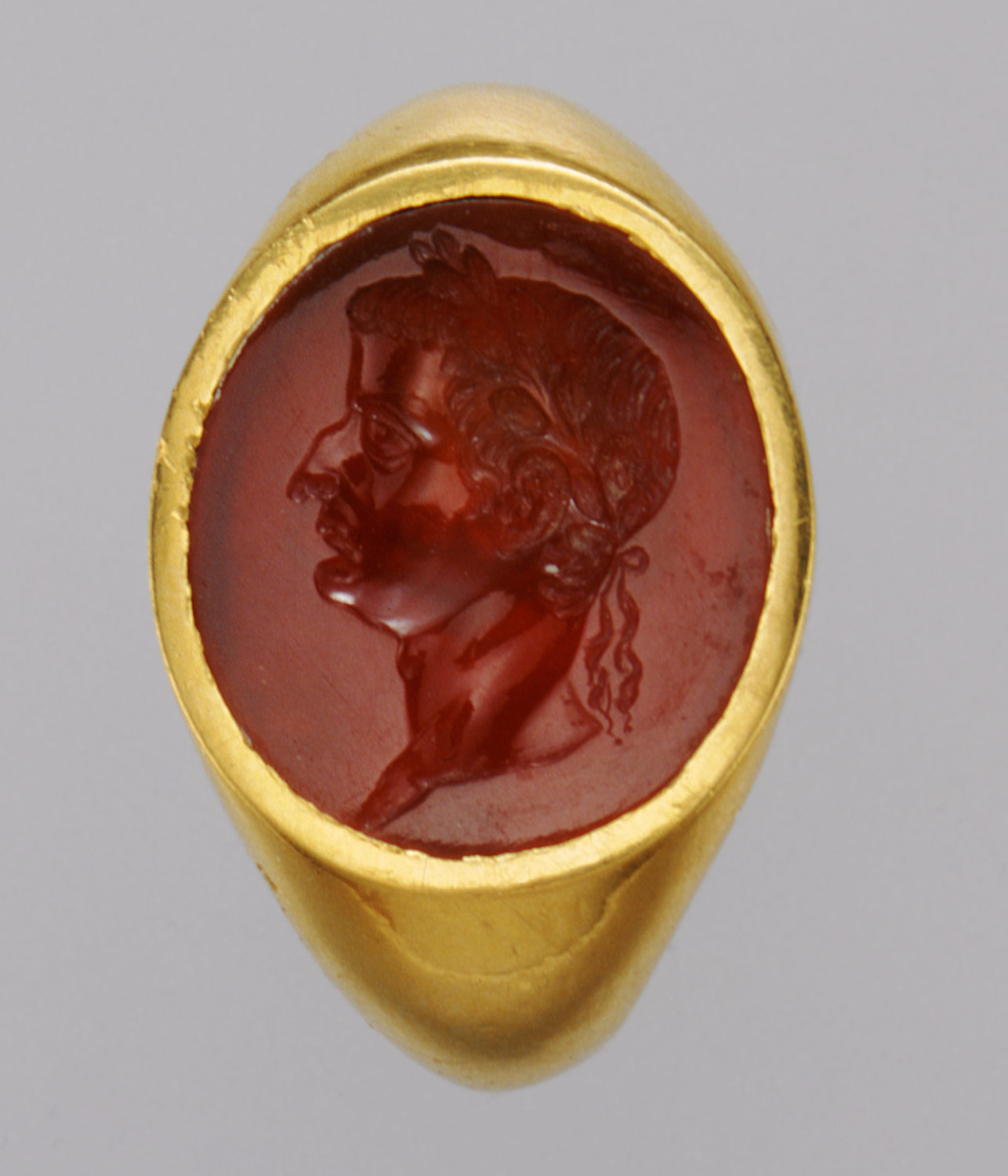Gold ring with carnelian intaglio portrait of Tiberius