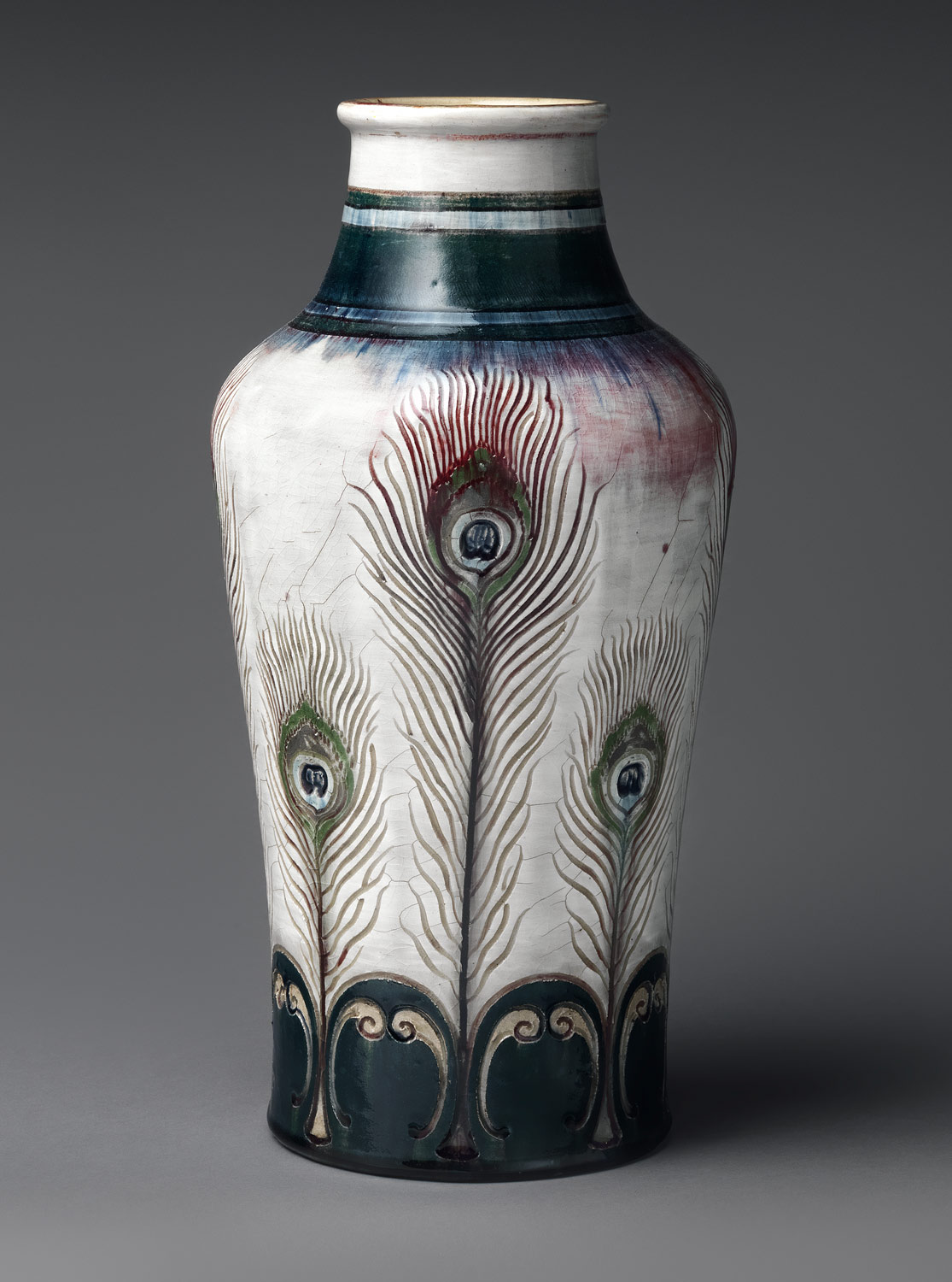 Vase with peacock feathers