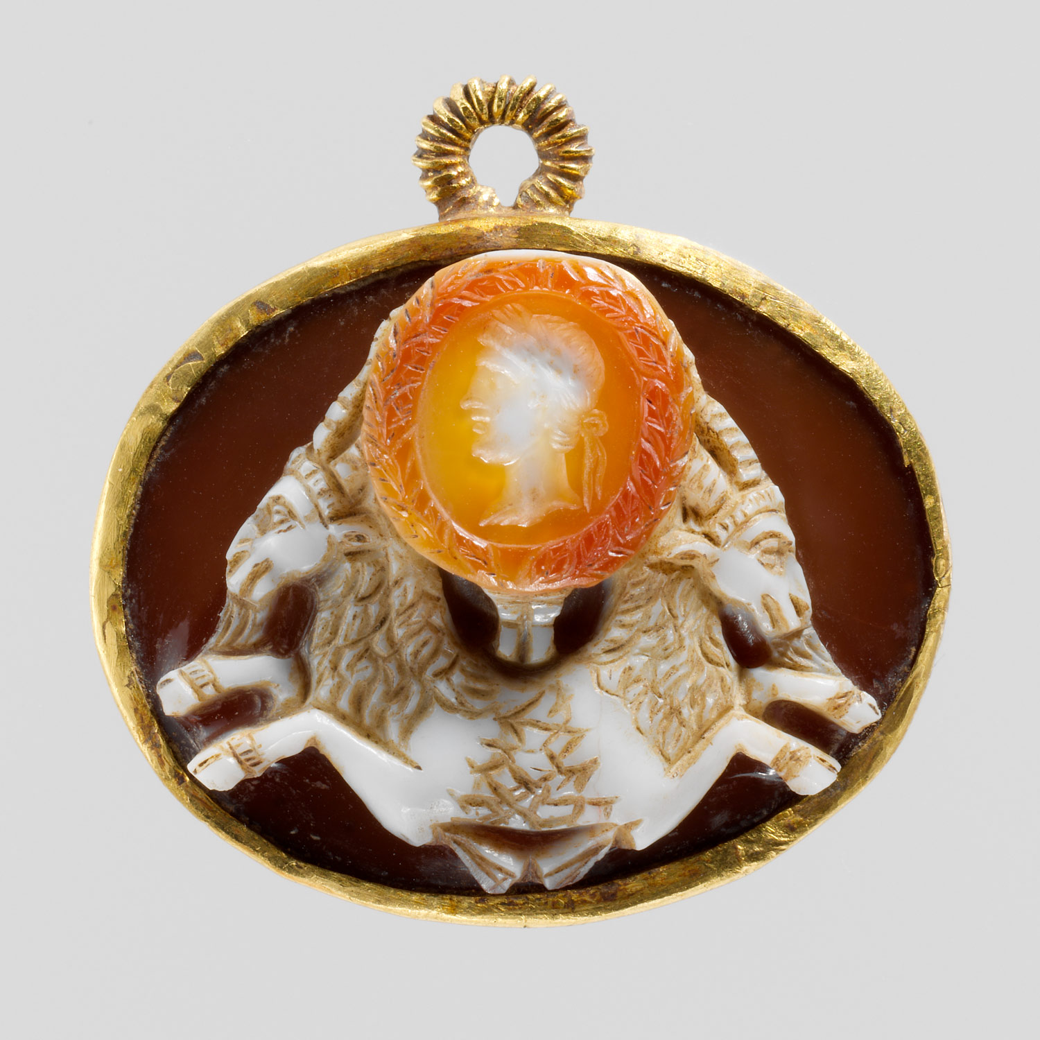 Sardonyx cameo of a double capricorn with a portrait of the emperor Augustus