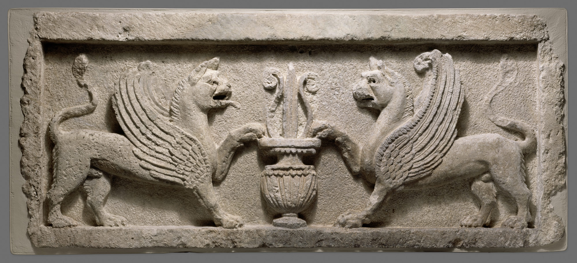 Door lintel with lion-griffins and vase with lotus leaf