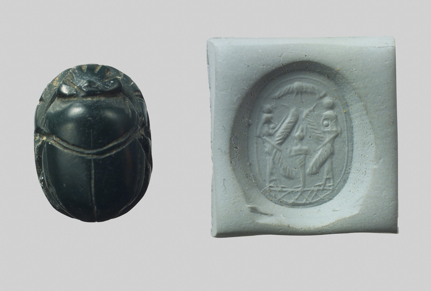 Scarab seal and modern impression: Osiris flanked by protective deities