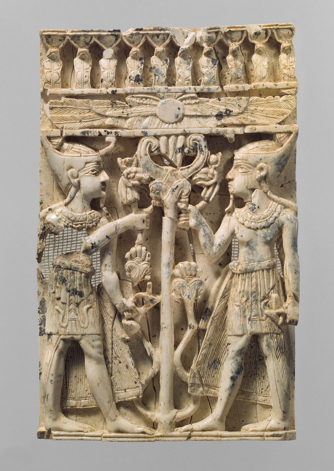 Plaque with pharaonic figures flanking a sacred tree