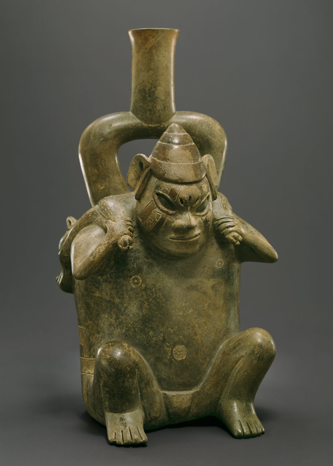 Stirrup Spout Bottle: Figure Carrying Deer