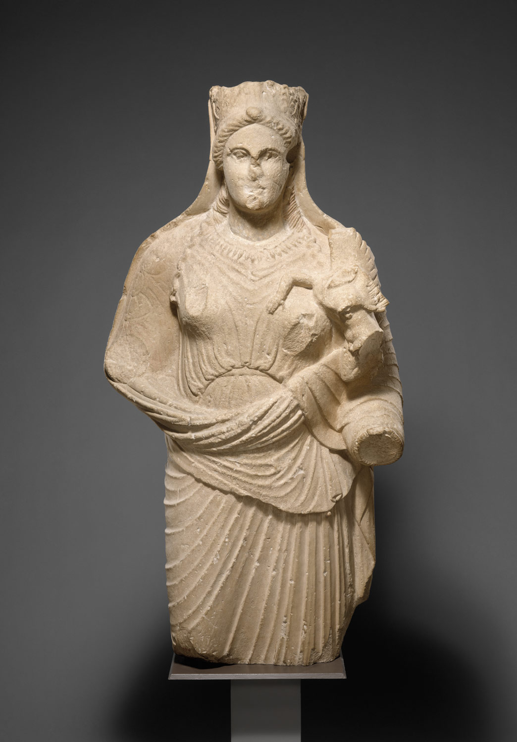 Limestone statue of Aphrodite holding winged Eros