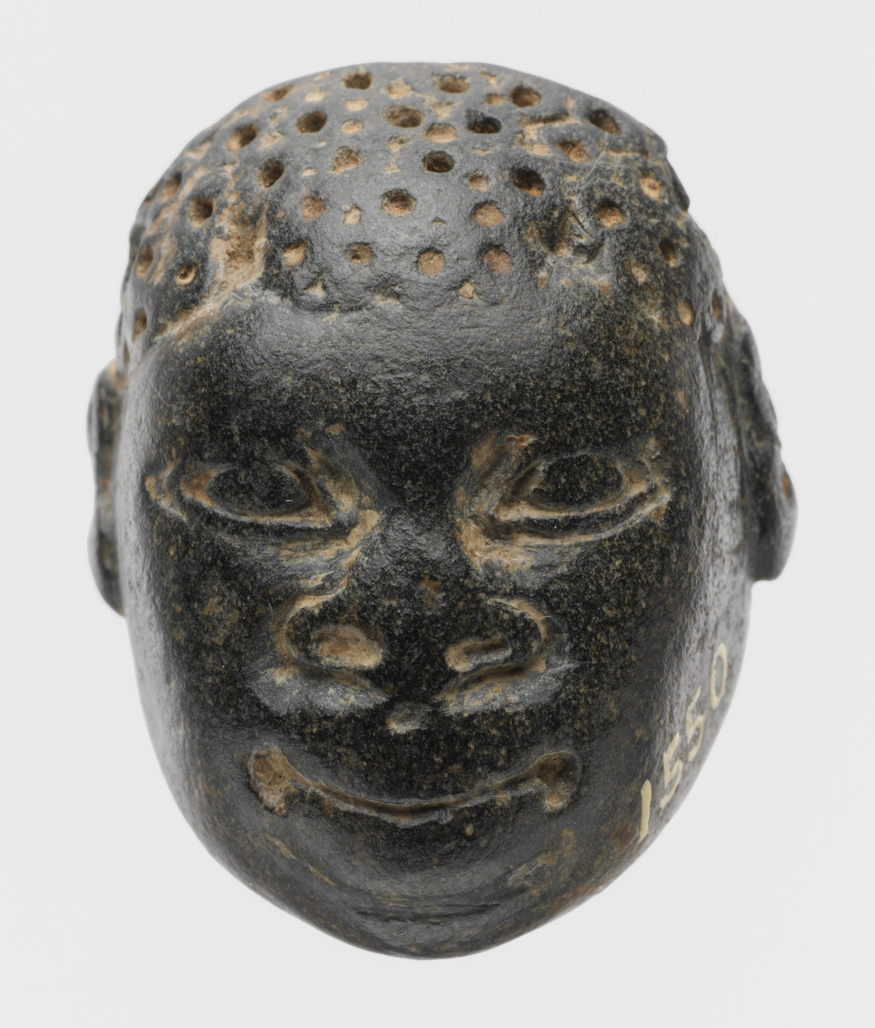 Chlorite pendant in the form of the head of an African (known as Ethiopian)