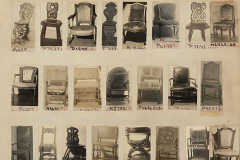 A page from an album with small thumbnail-sized black-and-white photographs of antique chairs, each labeled with an inventory number