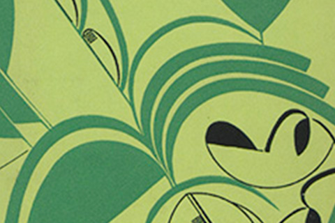 A close-up of an Art Deco-like abstract design in light green, dark green, and black