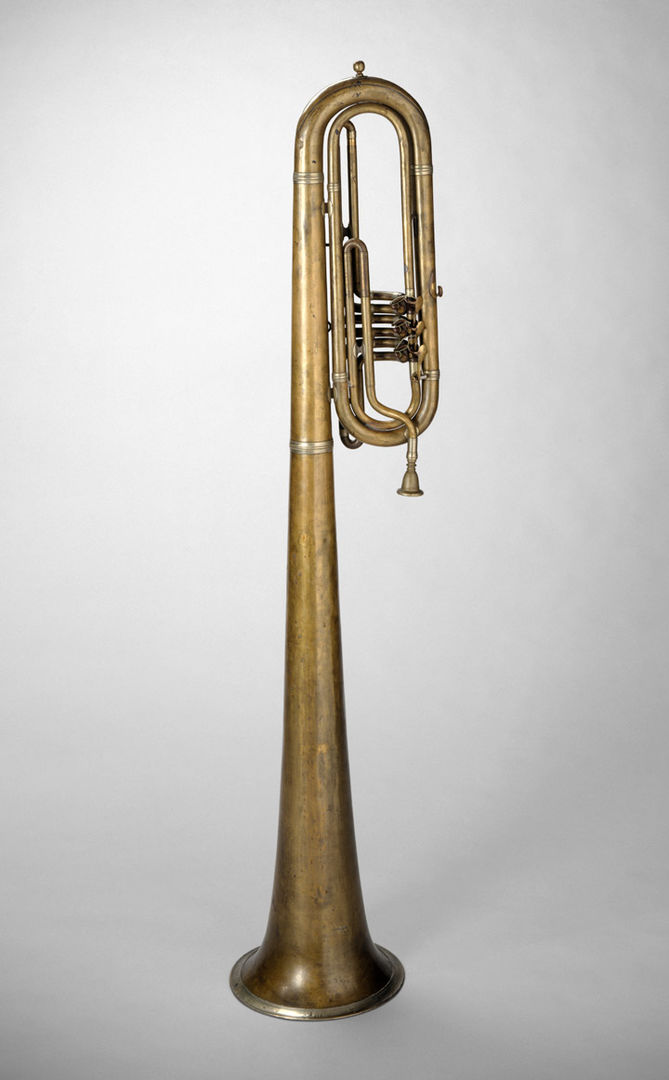 A tall low brass instrument meant to be played over the shoulder