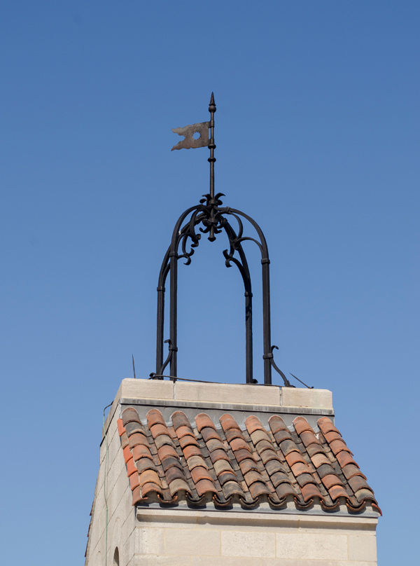 Bell frame with pennant installed on the chimney