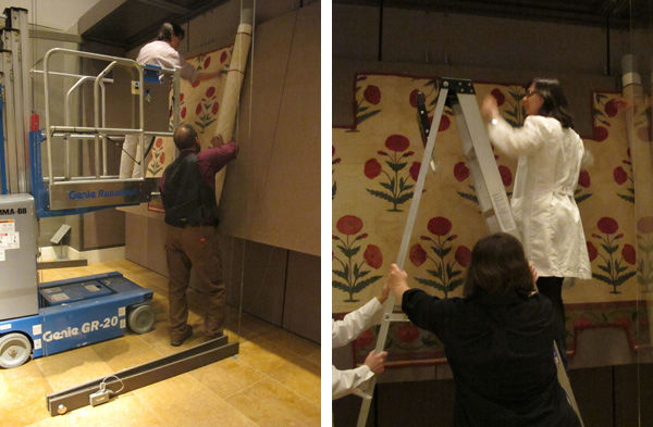 Left: Fig. 7. The pinning and unrolling of the textile during installation (1982.239a). Right: Fig. 8. Minor adjustments are made and more pins are added by conservators (1982.239a). Photos by Laura Peluso