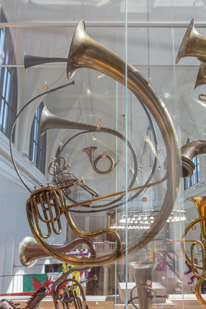 Side view of the large display of brass instruments featured in Fanfare