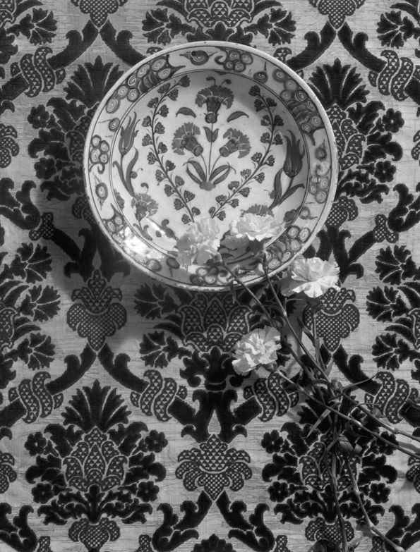 Iznik bowl displayed with live carnations and an Italian velvet, 1933