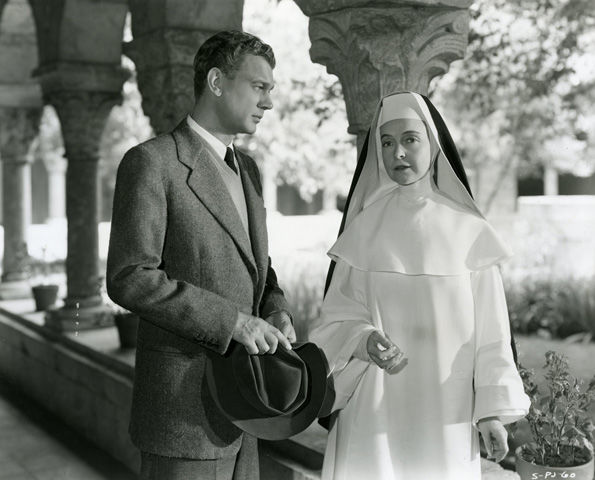 Joseph Cotton and Lillian Gish pose in the Cloister from Saint-Michel-de-Cuxa (25.120.398–.954) during the filming of Portrait of Jennie in 1947.