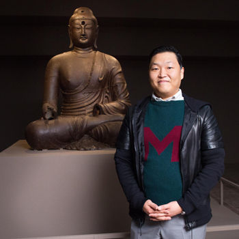Psy with Iron Buddha