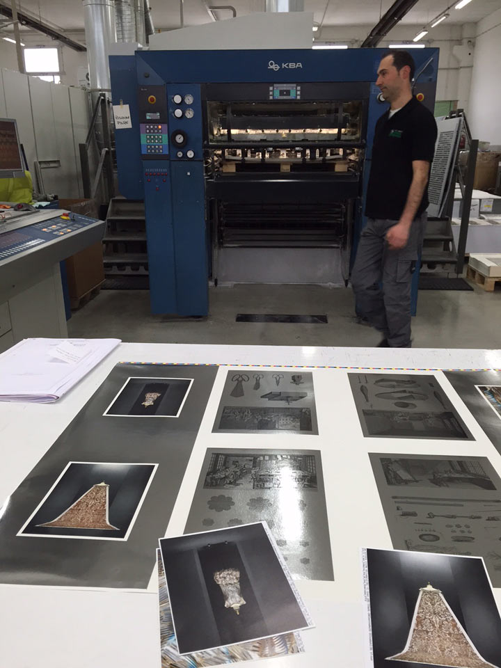 Printed pages lying on a table in a factory