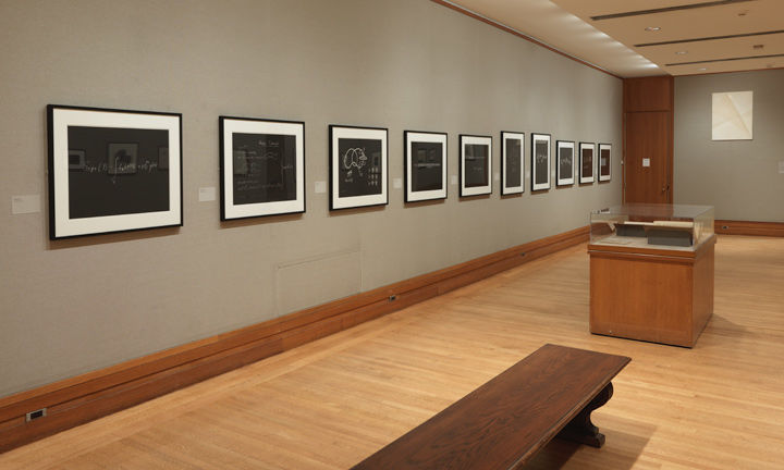 Gallery view of a wall of 10 aquatint prints, each depicting a mathematical equation
