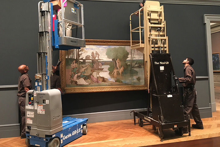 Excitement builds as art begins to repopulate the gallery. Here, painting technicians and riggers install a painting called The River by Rodin's friend Puvis de Chavannes on the gallery's south wall