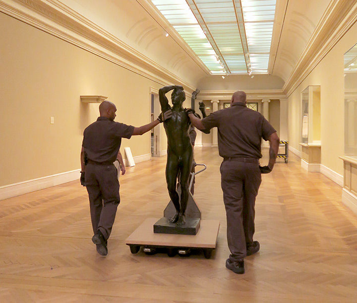The Age of Bronze making its exit with Museum riggers (responsible for moving large-scale artworks) Lionel Carre (left) and Derrick Williams (right).