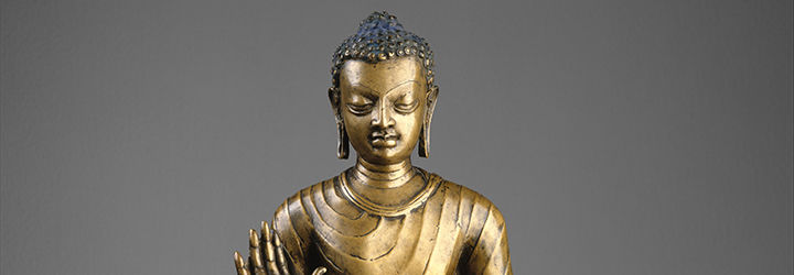 A detail of a bronze sculpture of a Buddha, made in India during the Gupta period.