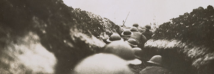 A photograph from WWI showing soldiers marching through the trenches.