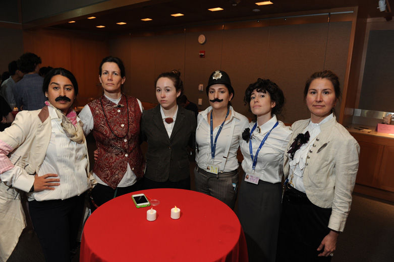 Met staff members pose for a very serious picture in nineteenth-century dress.