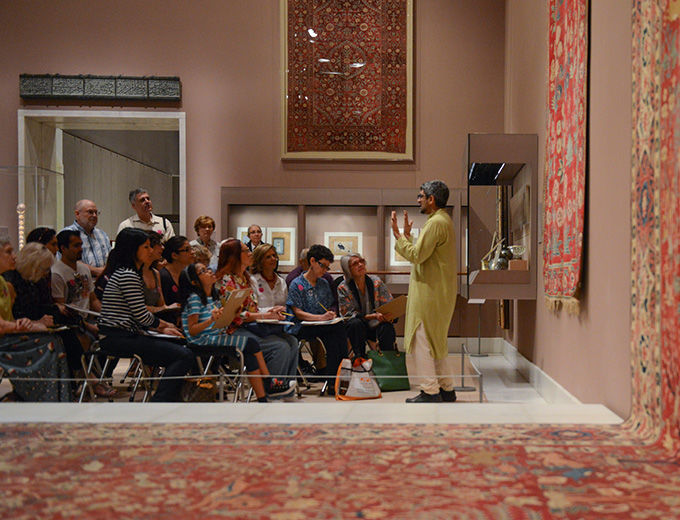 Visitors listening to a gallery talk about Persian objects