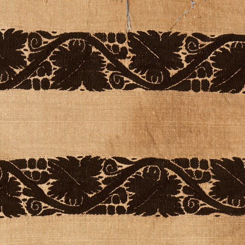 An Egyptian textile featuring vine patterns