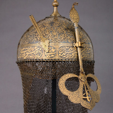 Detail view of an 18th-century Islamic helmet made of steel, gold, and copper