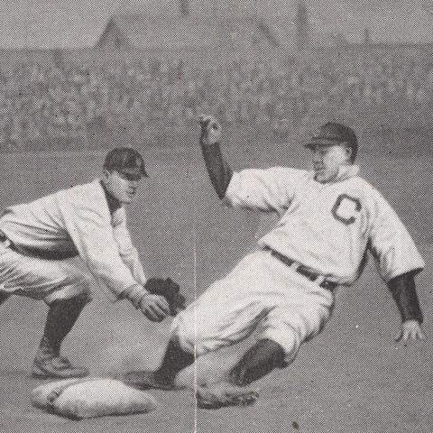 Detail of a photo of two baseball players in action on the field