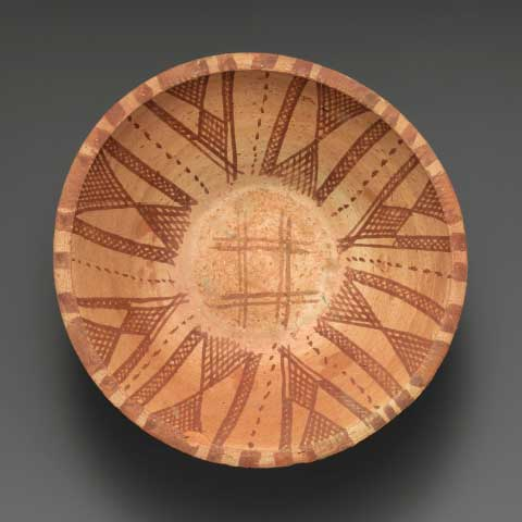 Bowl with interior geometric decoration