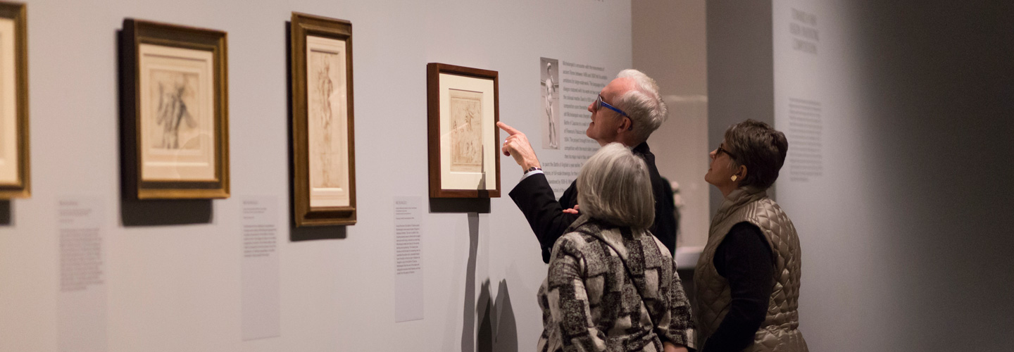 A group of art lovers admire a Michelangelo drawing at The Met