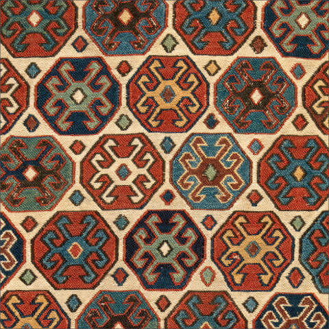 Detail of colorful woven sumak pattern on a double saddle bag from Iran.