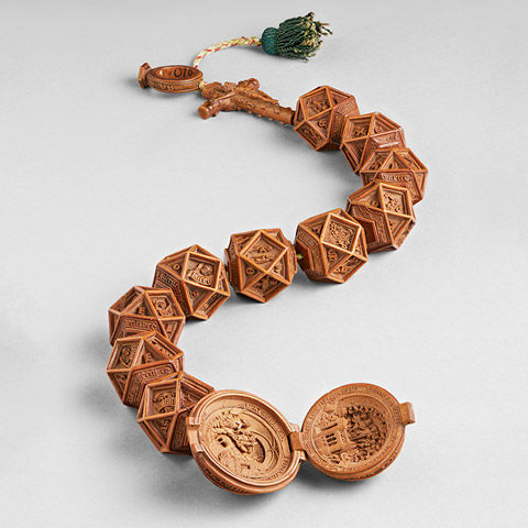 String of intricately carved, wooden rosary beads