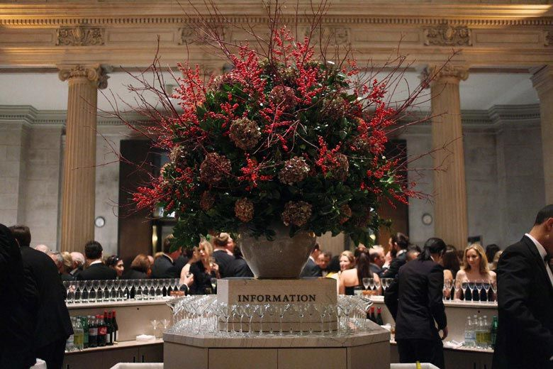 Dining in the Great Hall with huge flower arrangement