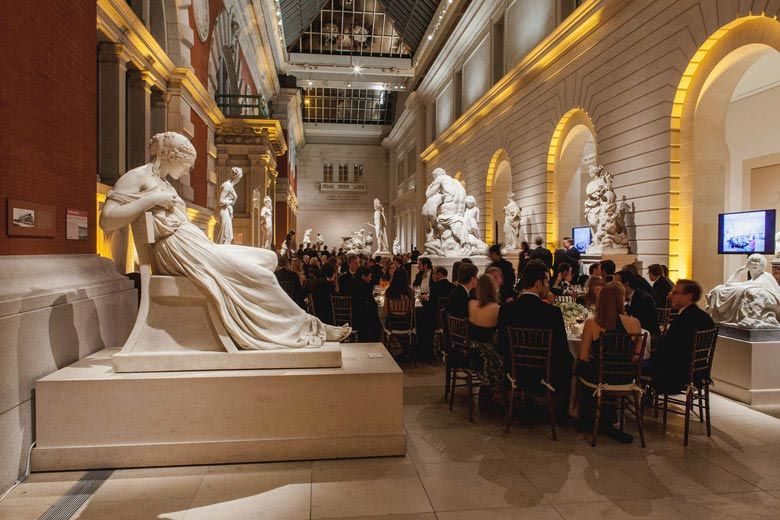 Dining in Petrie Court among white marble sculptures and gold lighting