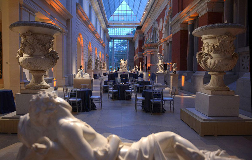 Dining tables in Petrie Court with reclining white marble sculpture