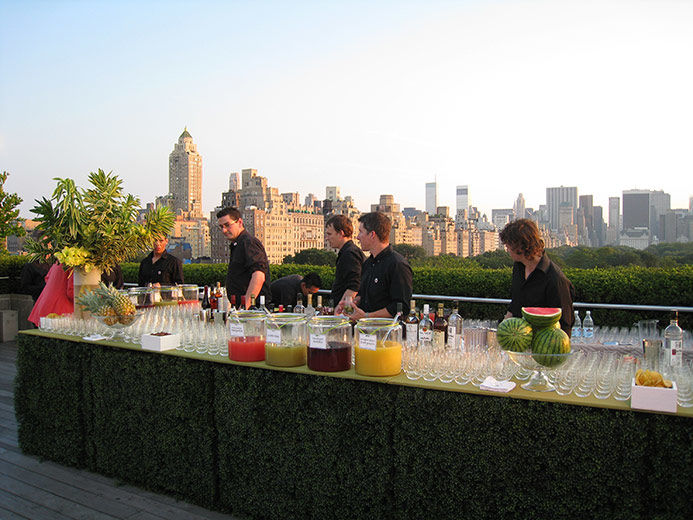 Daytime view of the bar on the roof garden with skyline in the background