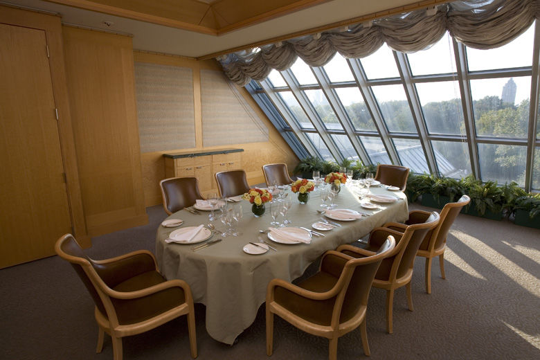 An Intimate And Elegant Room With Skylights At The Far End A Dining Table