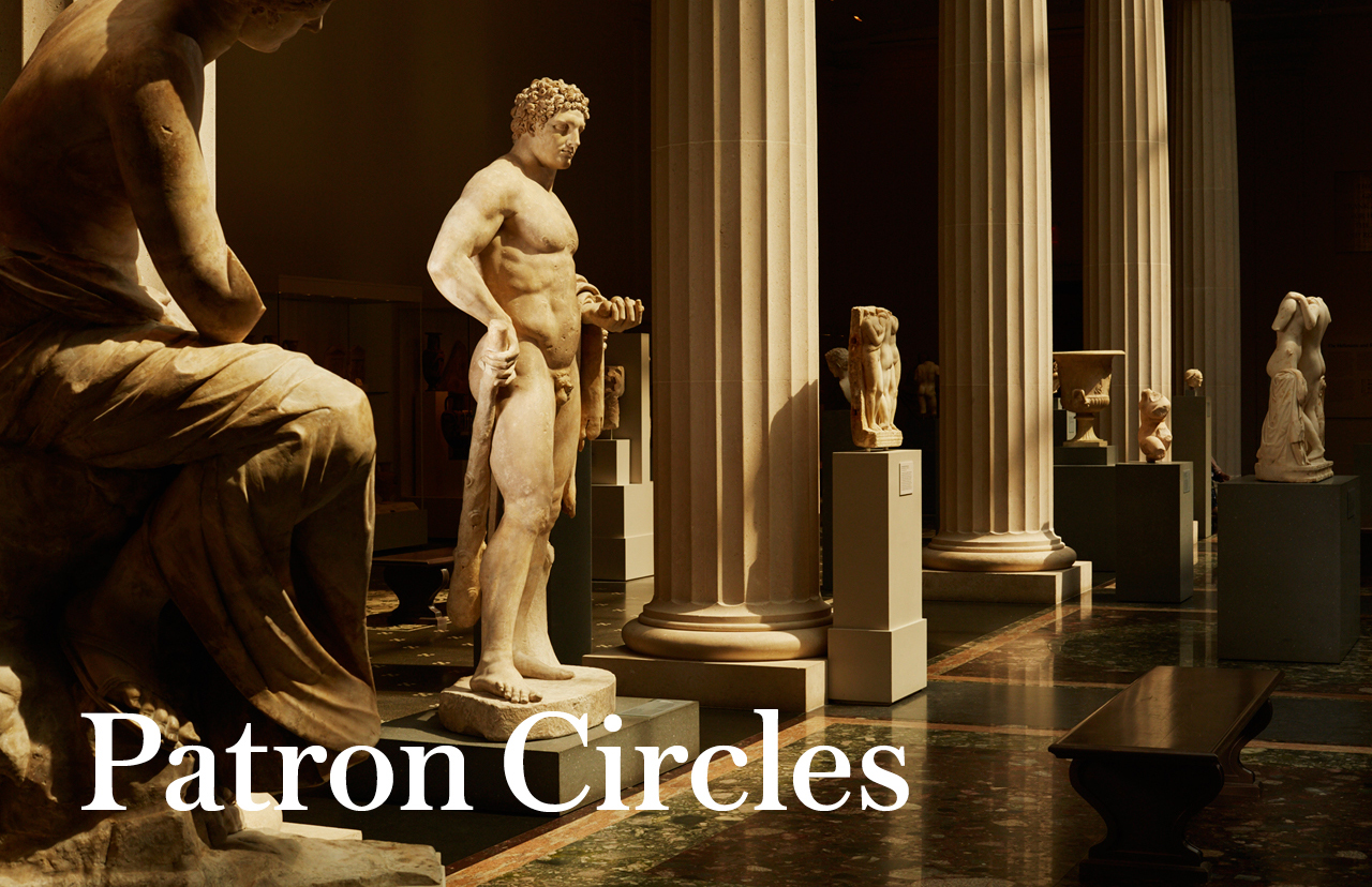 Patron Circles | View of a group of ancient Roman sculptures in a dimly lit gallery
